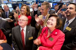 RE/MAX CEO Margaret Kelly in the center of the trading crowd as RE/MAX stock opens for trading on the NYSE. (center, left)